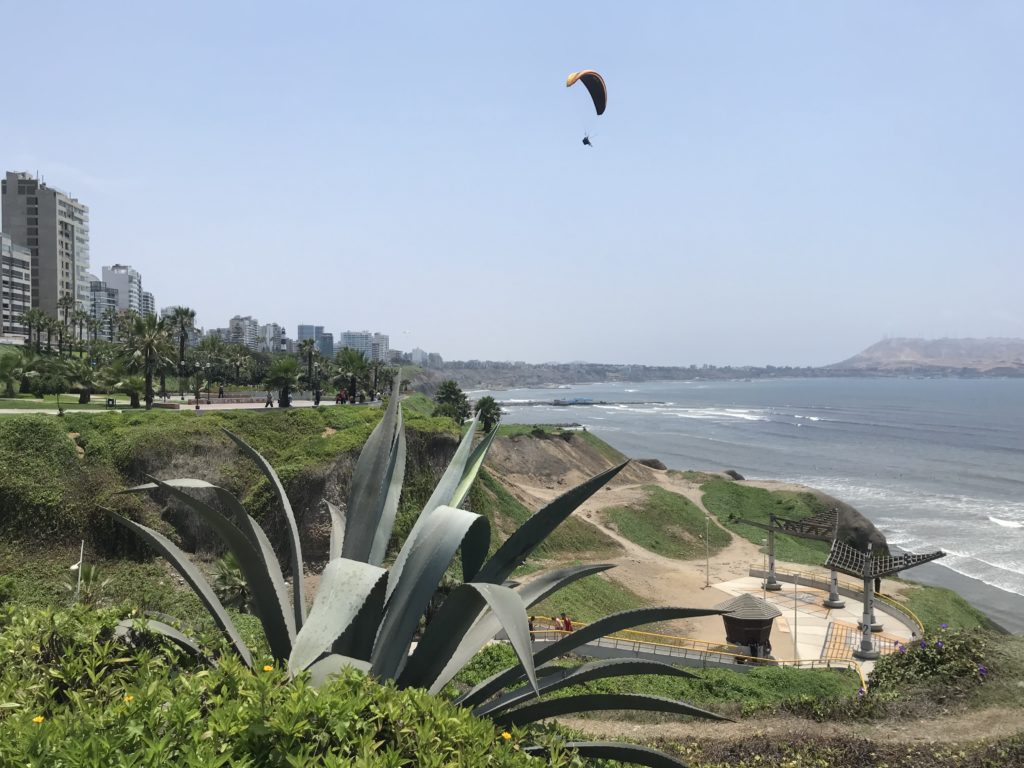 A paraglider over the Malecón boardwalk in Miraflores.