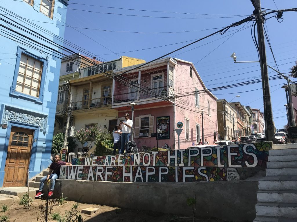 We are not hippies, we are happies sign on Templeman street, Valparaíso.