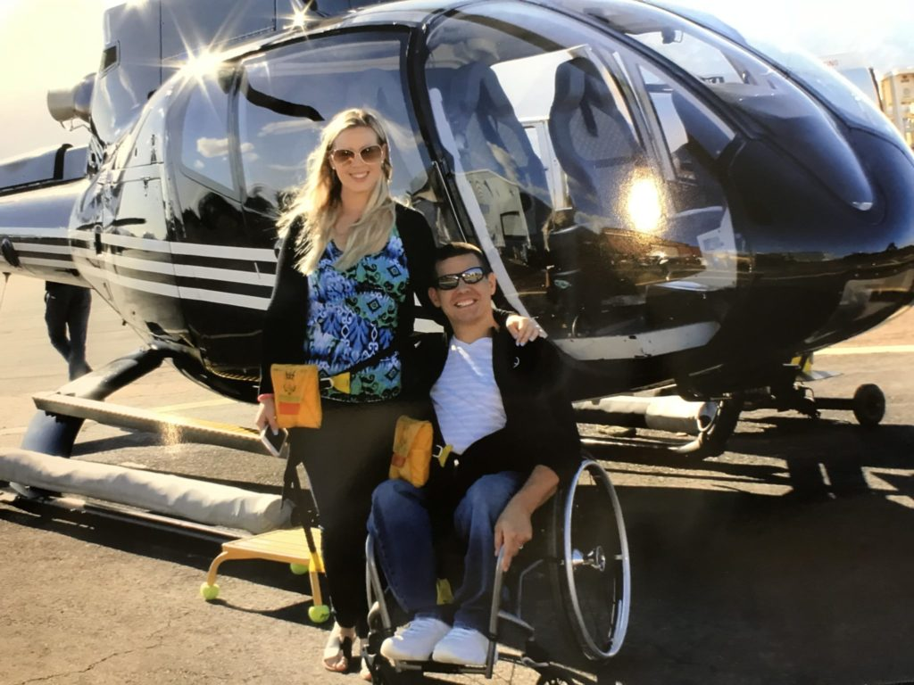 A picture of Josh and Mary-Kate by a helicopter.
