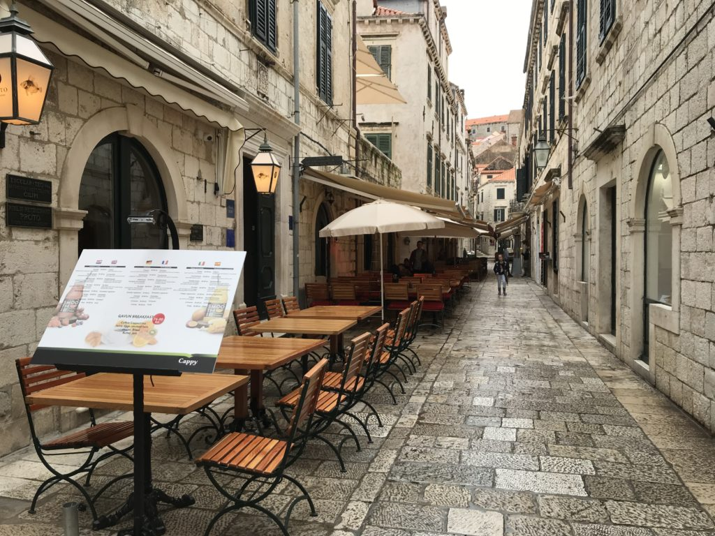 There are a variety of outdoor accessible restaurants, like this one, in Dubrovnik's old town.