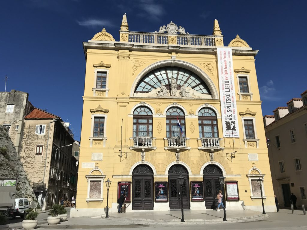 A picture of the front of the Croatian National Theater in Split.