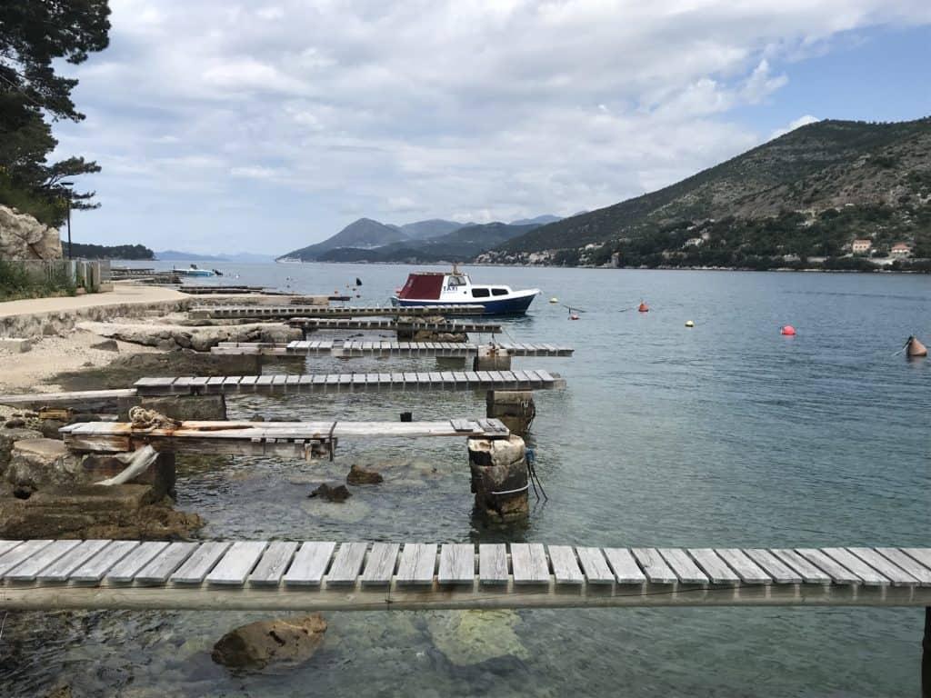 Small docks along the boardwalk of Lapad.