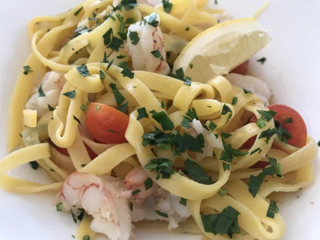 A shrimp and pasta dish.