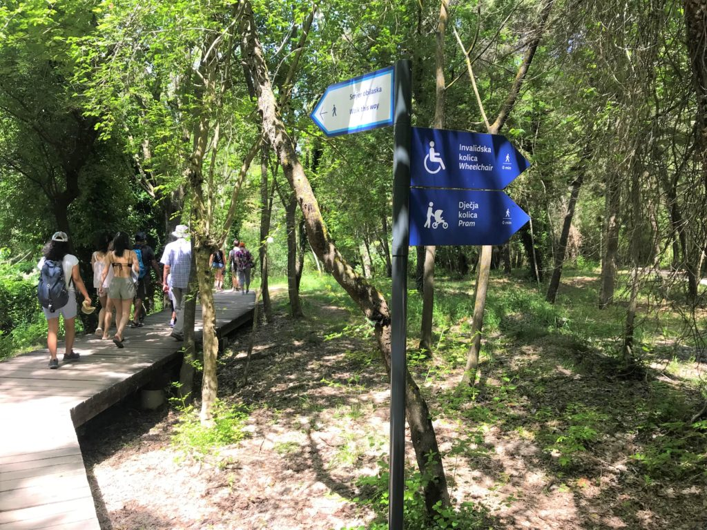 Wheelchair accessibility signs at Krka National Park.