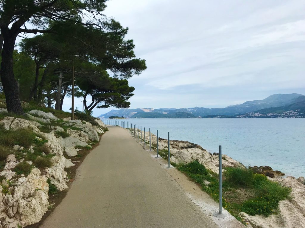 A flat, paved path along the Cavtat boardwalk, which is a great activity to do with a day trip to Cavtat.