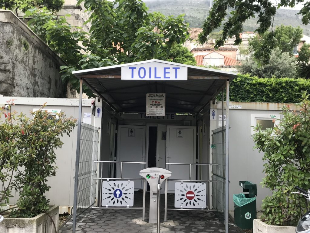 A wheelchair accessible restroom is located near Pile Gate.