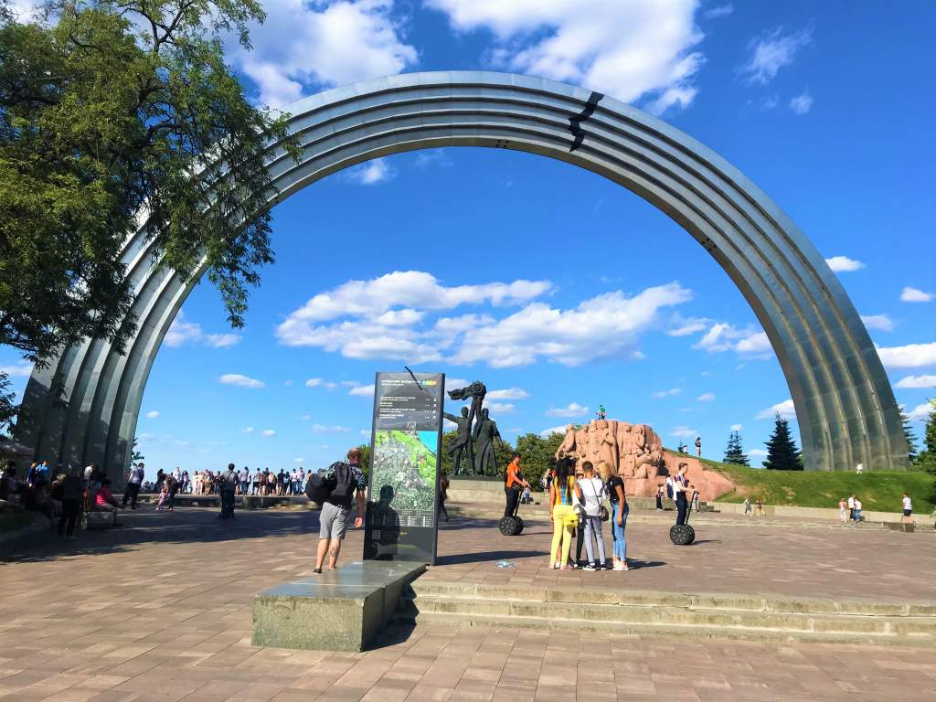 A wheelchair accessible ramp to the left leading to People's Friendship Arch in Kyiv.