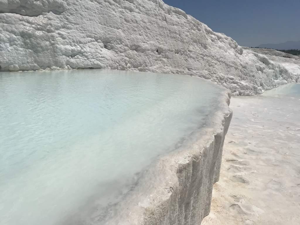 Pretty blue water and white tavertines at Pamukkale.