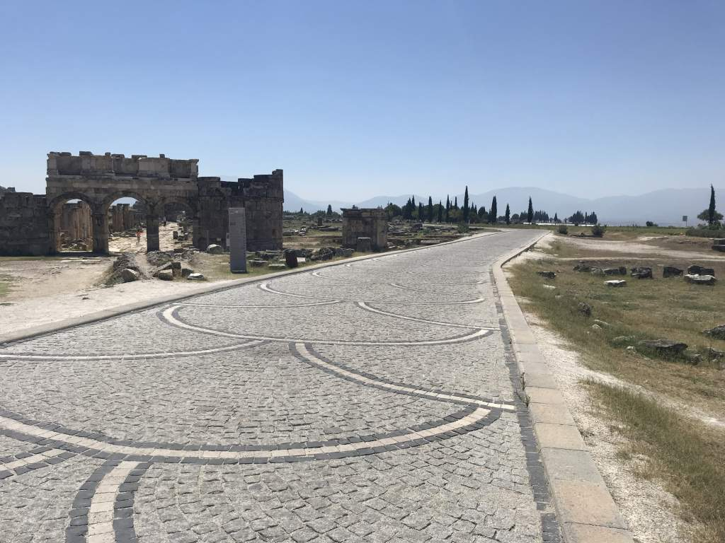 A cobblestone path leading through the hierapolis in Pamukkale is wheelchair accessible.