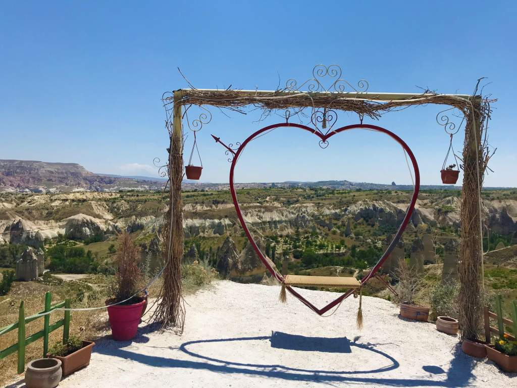 A heart swing over looking Love Valley.  Going up to this swing is accessible in Cappadocia.