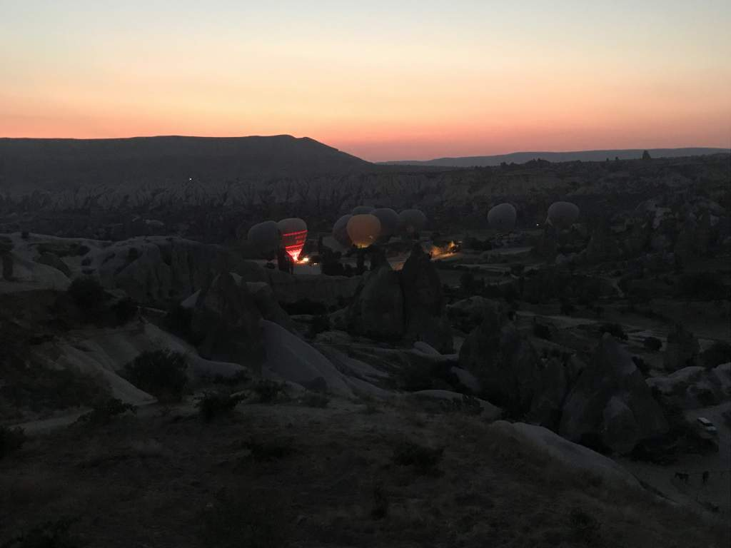 Hot air balloons filling with air before takeoff.
