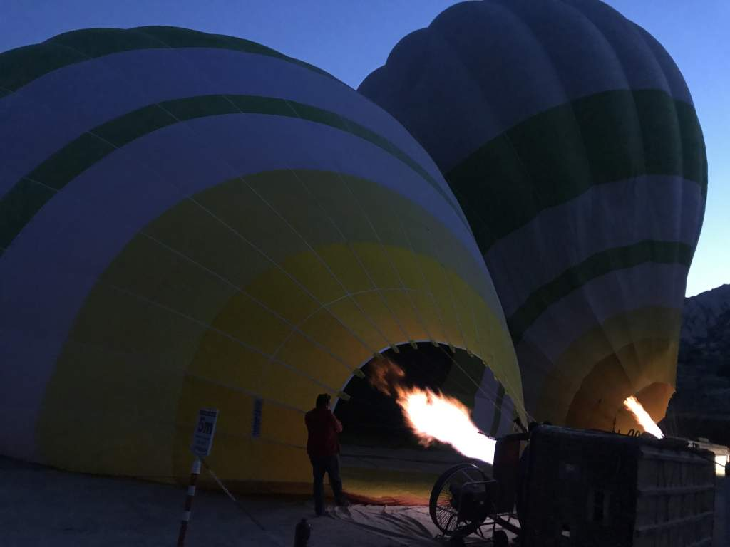Hot air balloons filling up before takeoff.