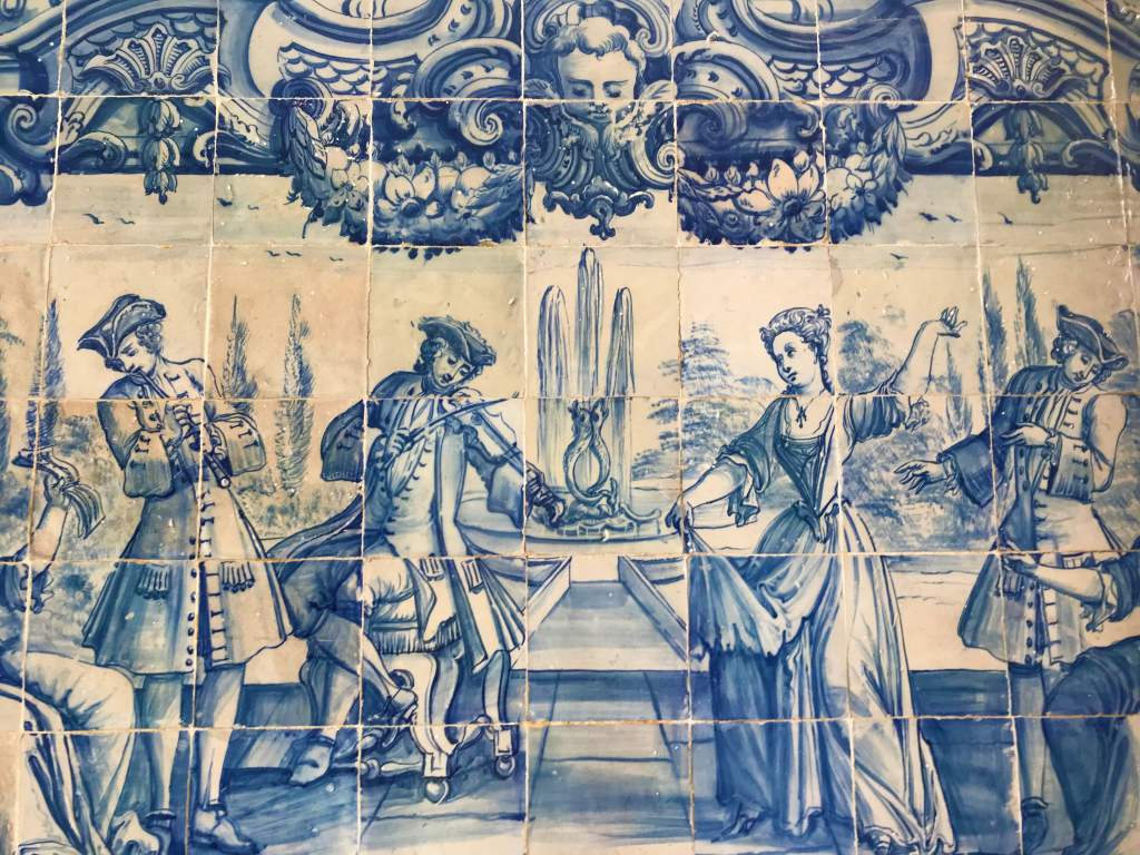 Blue tiles with artful depictions like this one are a common sight in Lisbon.