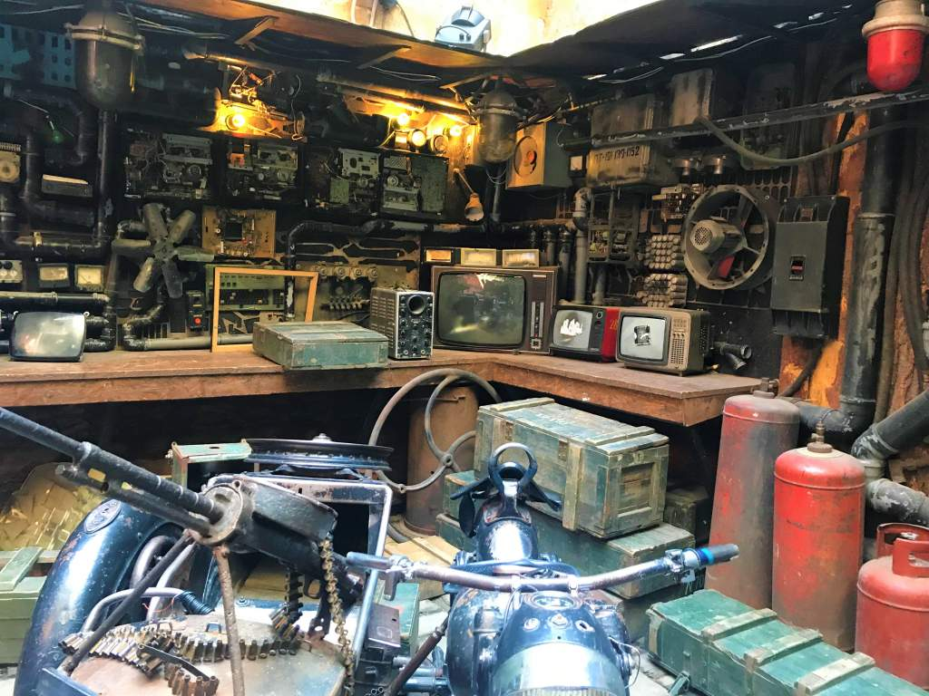 An array of old mechanical parts at Kryivka Bar.
