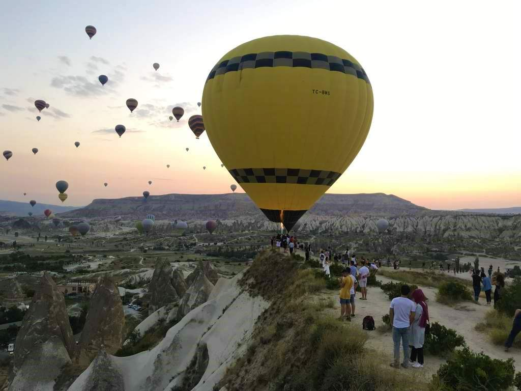Many of the balloons float over the Göreme viewpoint.