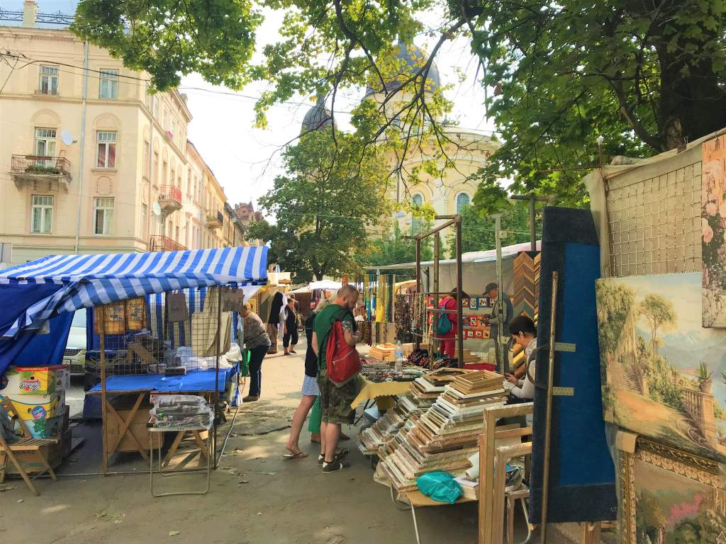 People shopping at Vernissage Market, which is one of the fun things to do in Lviv.