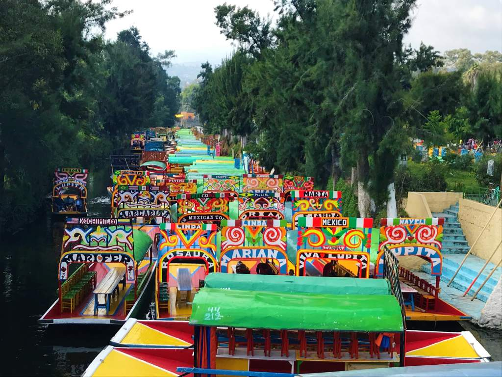 Boats lined up at the Embarcadero Nuevo Nativitas port in Xochimilco, which has a wheelchair accessible area.