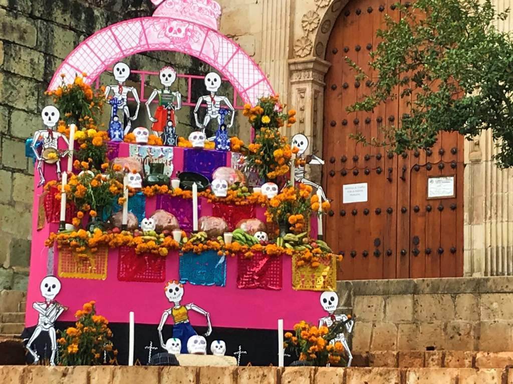 An outdoor offering for Day of the Dead outside of a cathedral in Oaxaca.