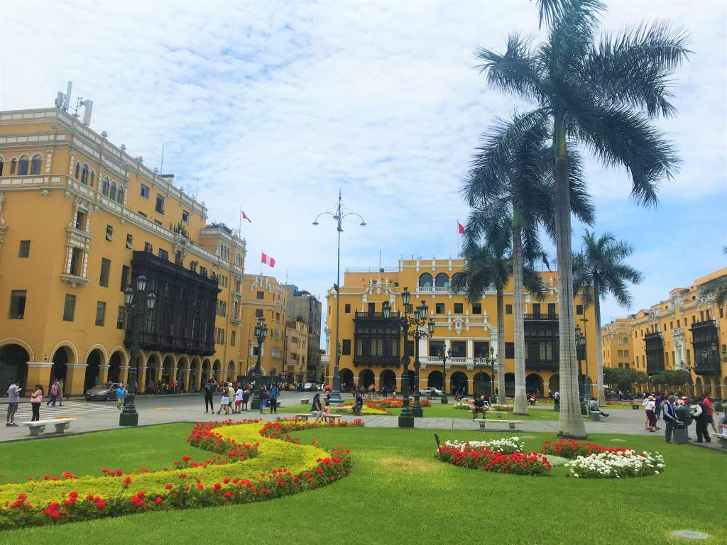 A view of yellow, historical buildings in Lima's historical center.