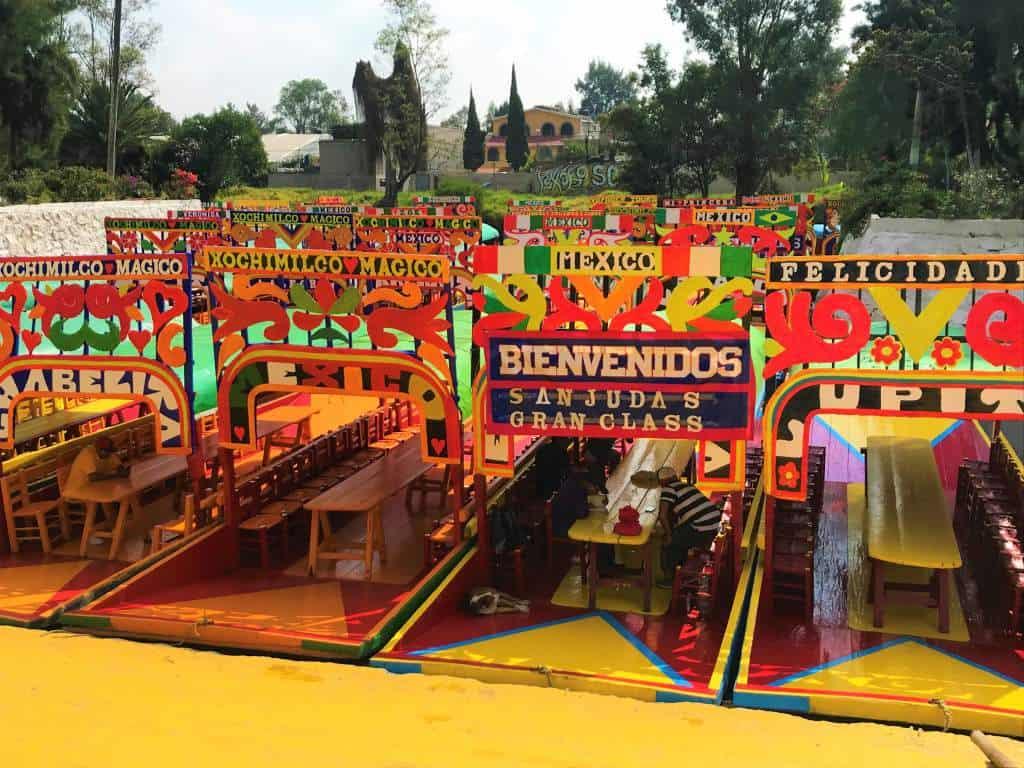 Trajinera boats lined up at the Embarcadero Nuevo Nativitas, a wheelchair accessible area in Xochimilco.