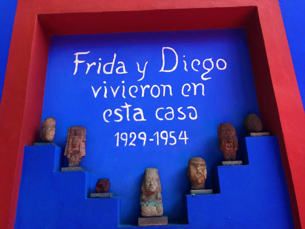 """A sign that reads """"Frida and Diego lived in this house 1929 - 1954."""""""