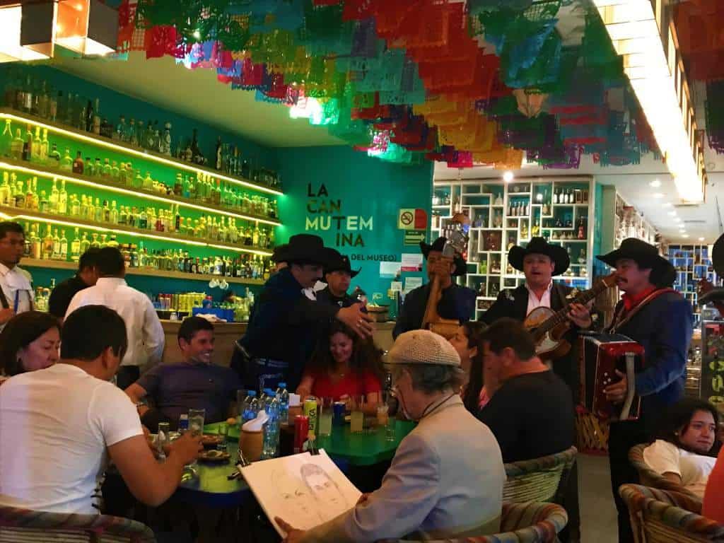 A Mariachi band playing at a restaurant in Plaza Garibaldi.