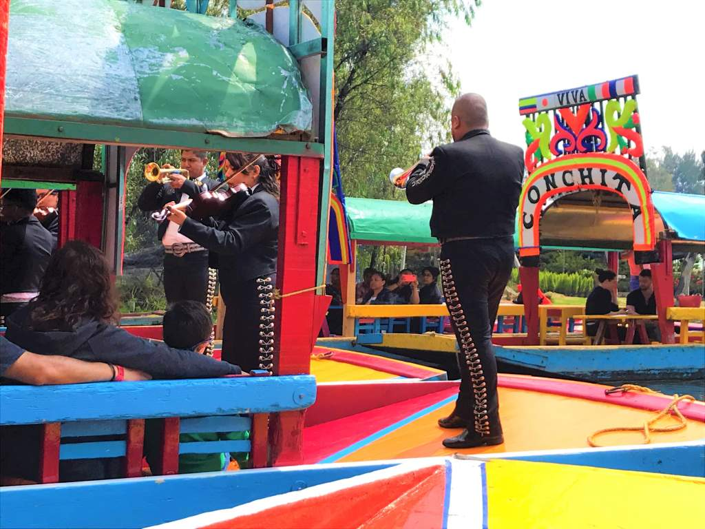 A mariachi band playing in the boat next to ours.