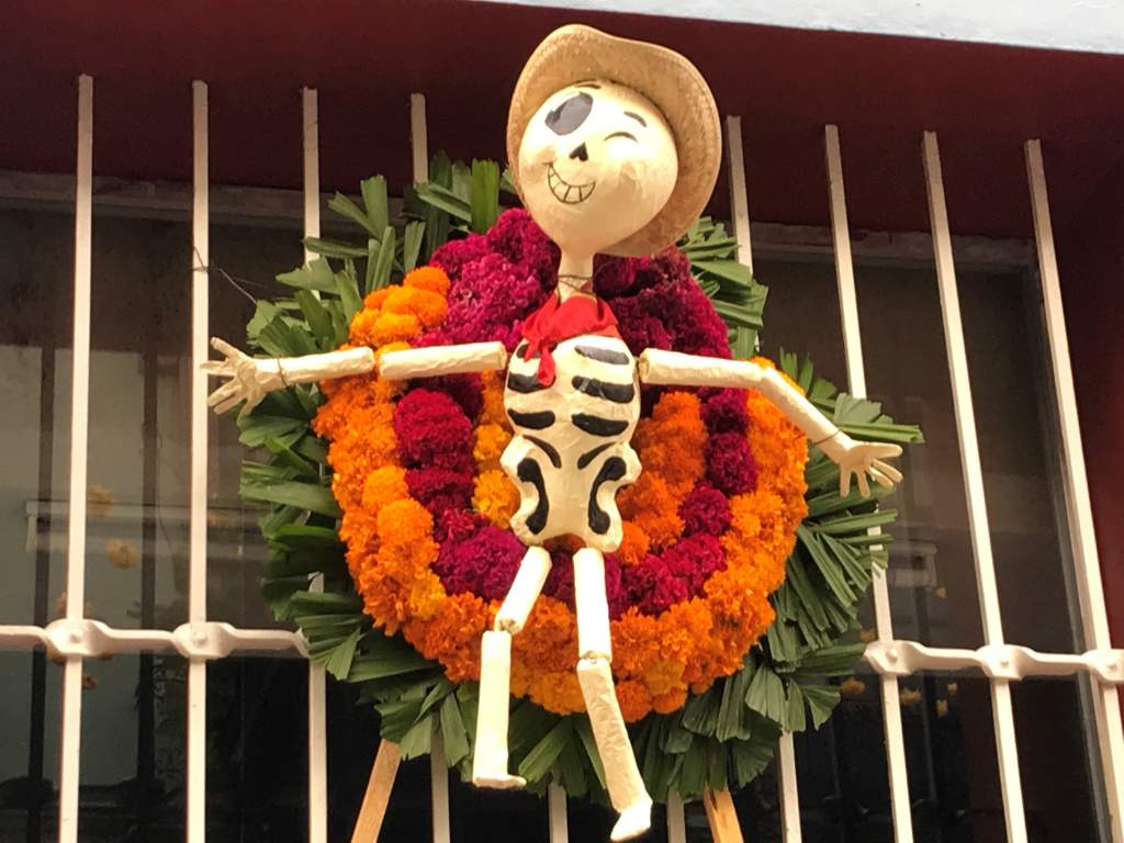 A cowboy skeleton on a wreath for Day of the Dead.