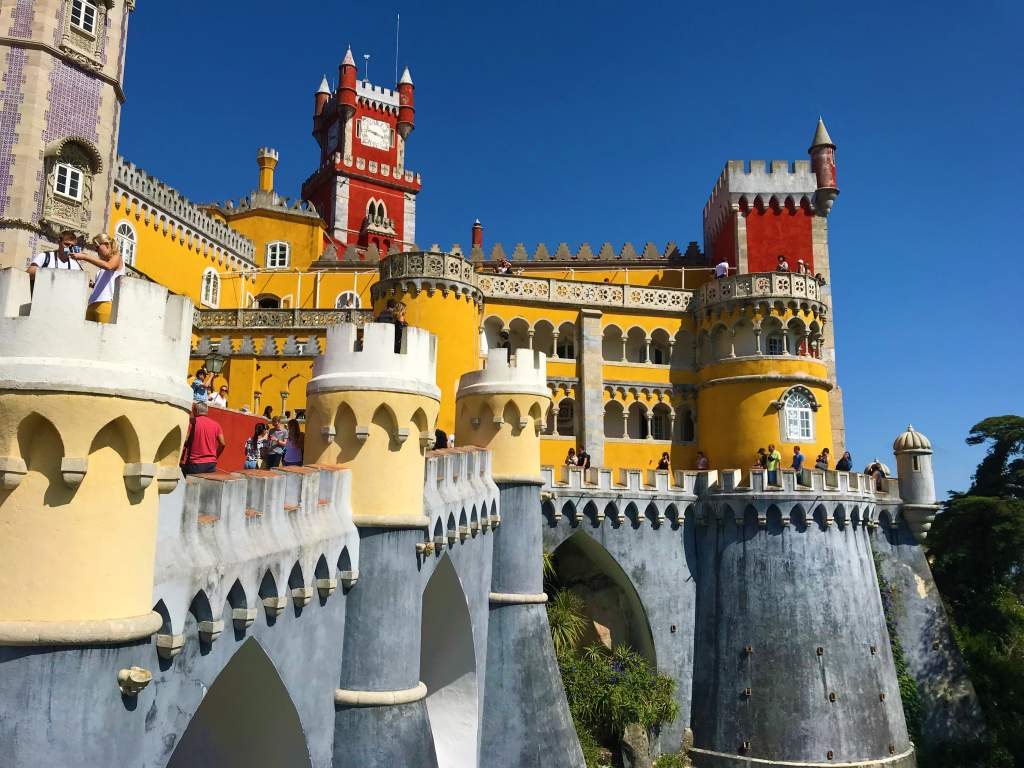 An outside view of the colorful Pena Palace.