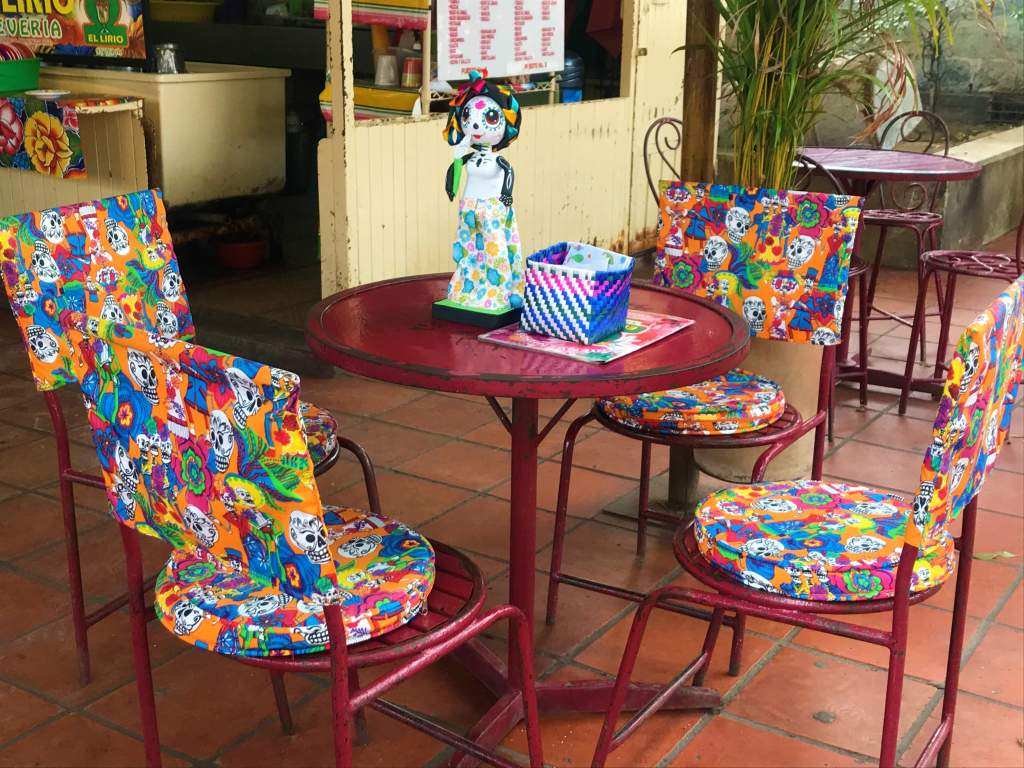 A local restaurant with Day of the Dead seat covers.