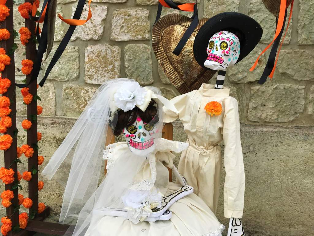 A bride and groom skeleton couple during Day of the Dead.