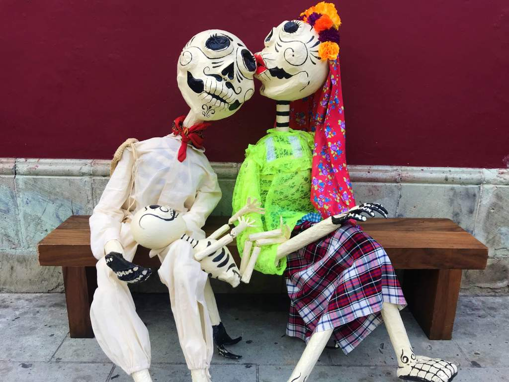 A skeleton couple kissing in Oaxaca for Day of the Dead.
