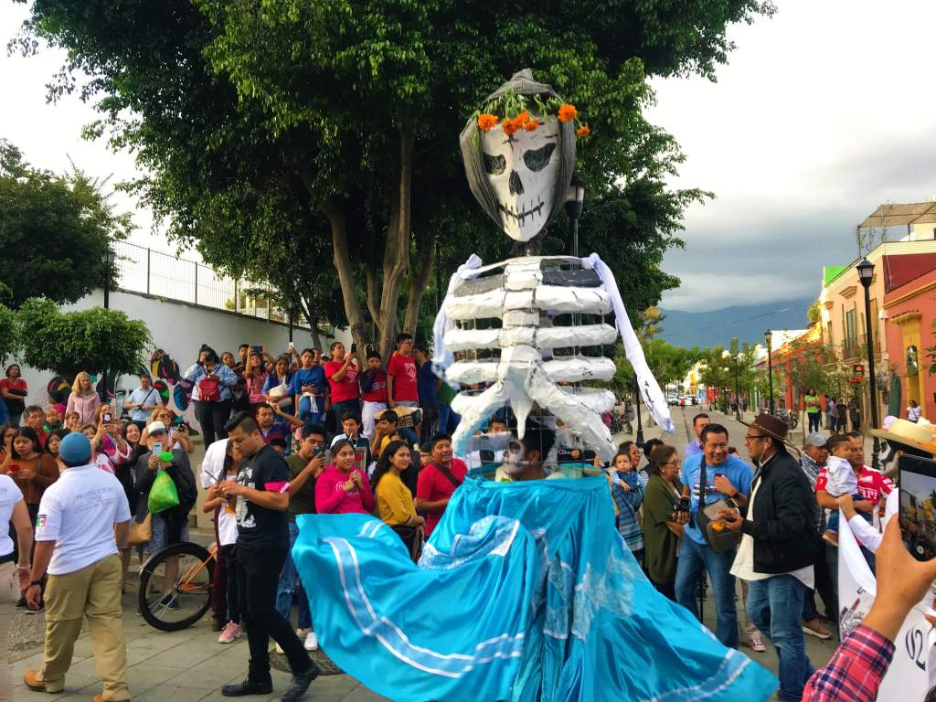 A dancing skeleton in the streets of Oaxaca for Day of the Dead.