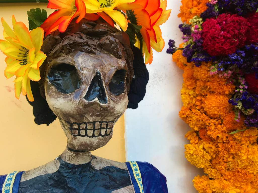 A skeleton women dressed up for Day of the Dead, which is a great wheelchair accessible event in Oaxaca.