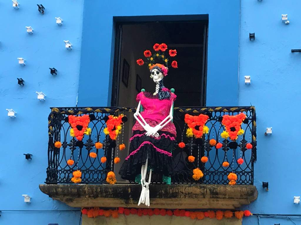 A skeleton on a balcony in Oaxaca for Day of the Dead.