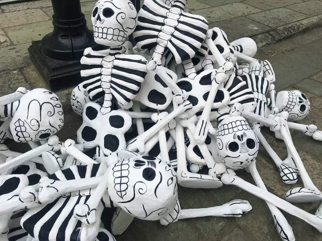 A pile of skeletons being ready to adorn Oaxaca for Day of the Dead.