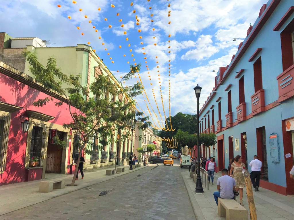A colorful, adorned road in Oaxaca for Day of the Dead.