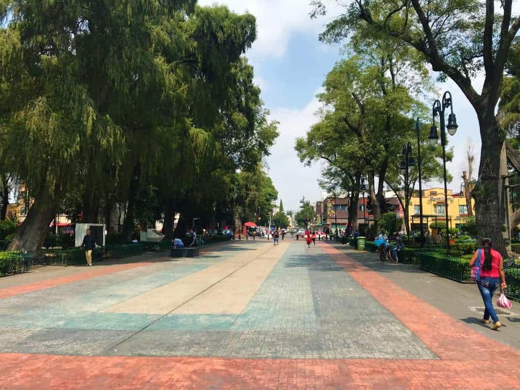 A wheelchair accessible path running through downtown Xochimilco.
