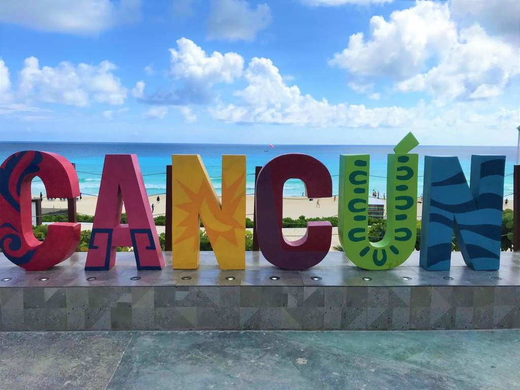 A colorful, touristy Cancun sign.