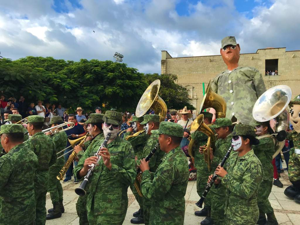The Mexican military playing in a band for Day of the Dead.