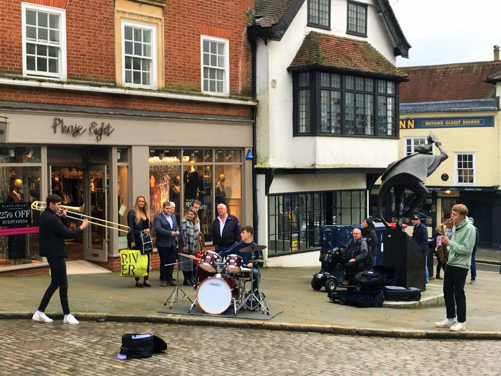 Musicians performing on High Street.