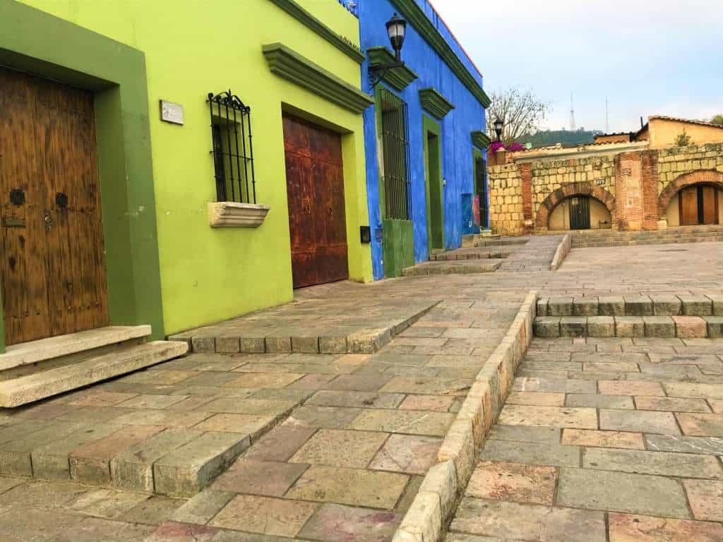 A wheelchair accessible ramp cuts through the Cruz de Piedra Plaza.