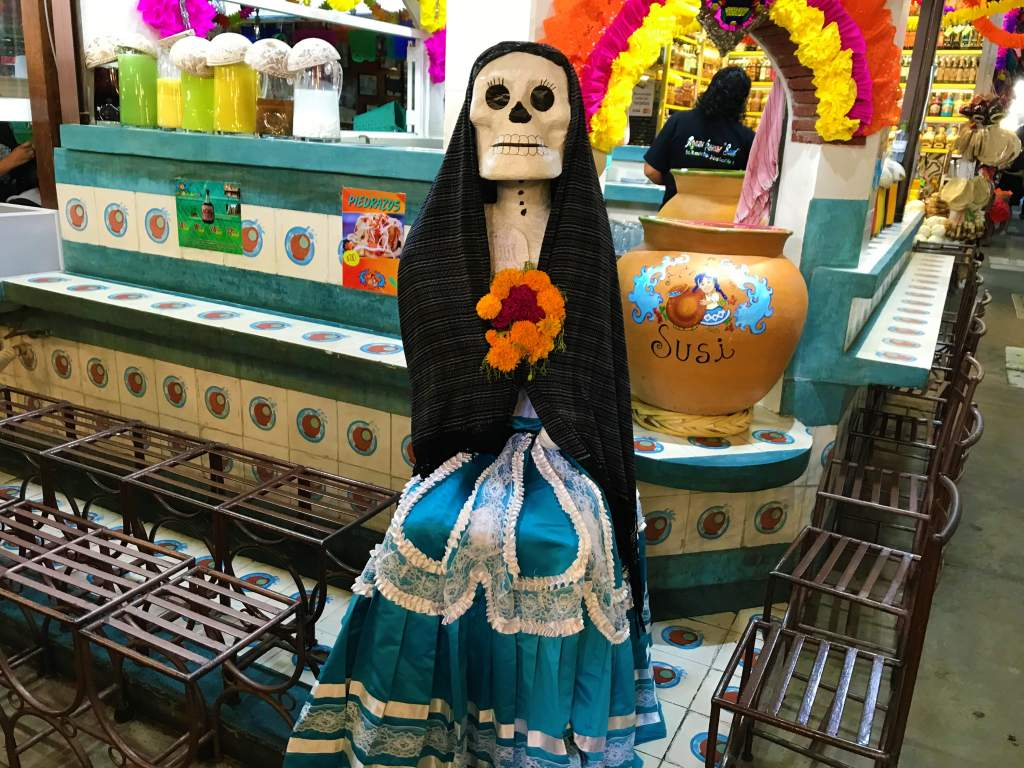 A skeleton dressed up at a market in Oaxaca.