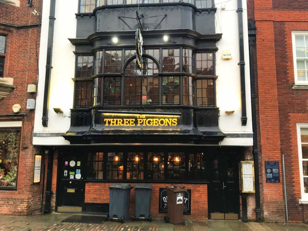 An outside view of The Three Pigeons pub.