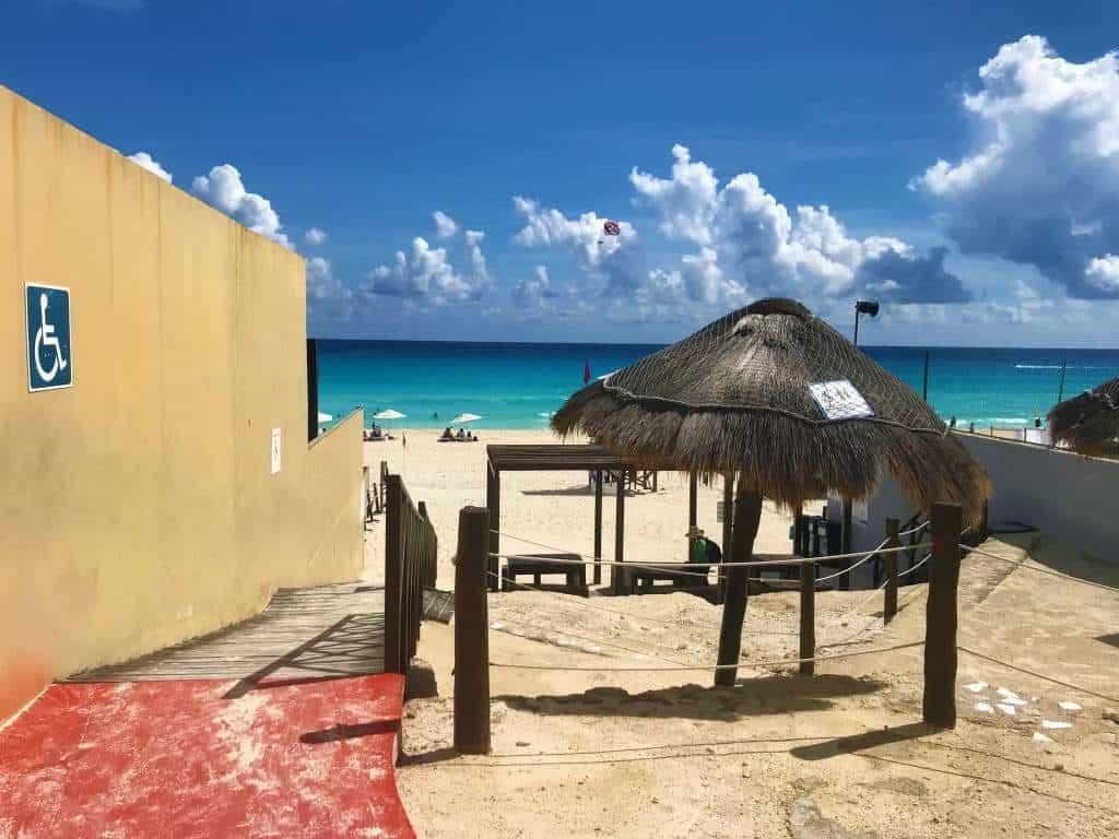A wheelchair accessible Cancun beach entrance.