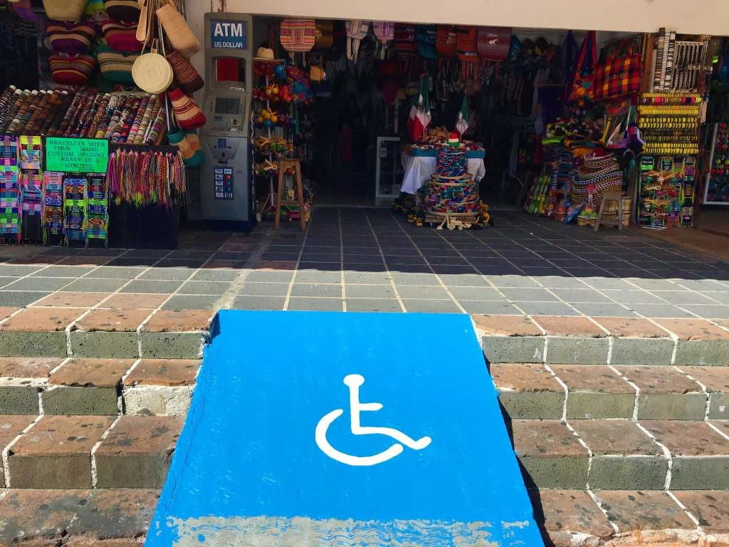 A wheelchair accessible ramp leading to the Coral Negro Flea Market in Cancun.