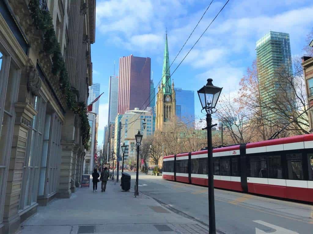 A tram running through downtown Toronto.