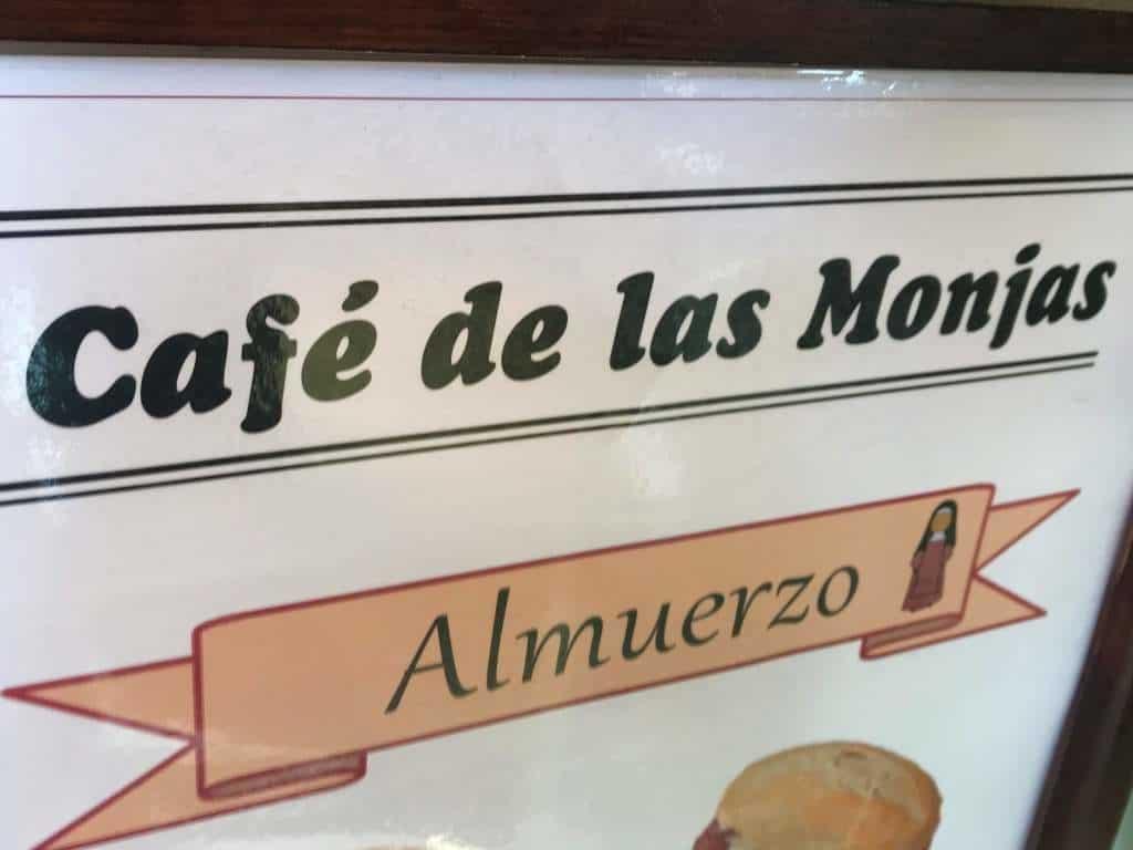"""A sign that reads """"Cafe de las Monjas""""."""