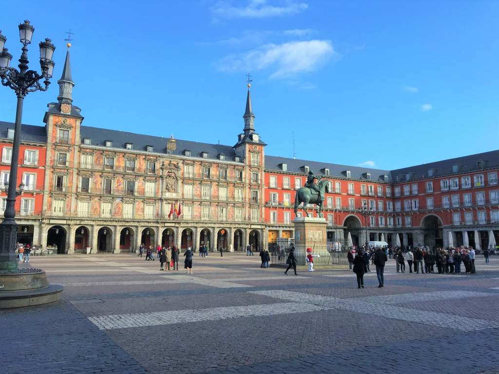 A view of the Plaza Mayor with its red buildings.