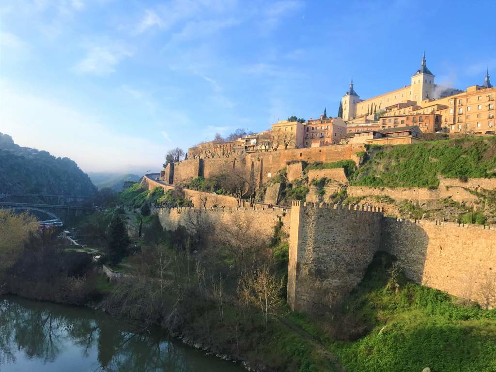 An iconic view of Toledo from the Alcántara Bridge.